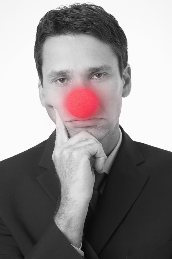 Uomo d'affari triste Wearing Clown Nose fotografia stock