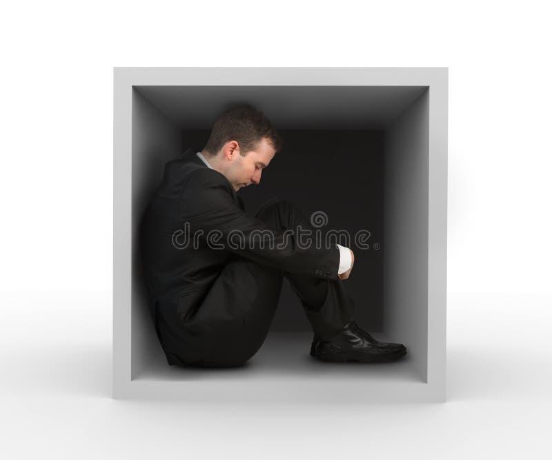 Uomo d'affari in una casella fotografia stock libera da diritti