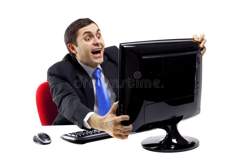 Uomo d'affari uscito davanti ad un video del computer immagini stock