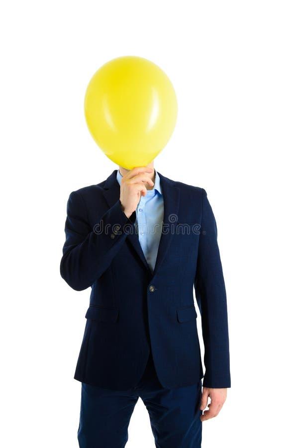 Uomo d'affari in vestito con impulso giallo dell'aria invece della testa, isolata su bianco fotografia stock libera da diritti