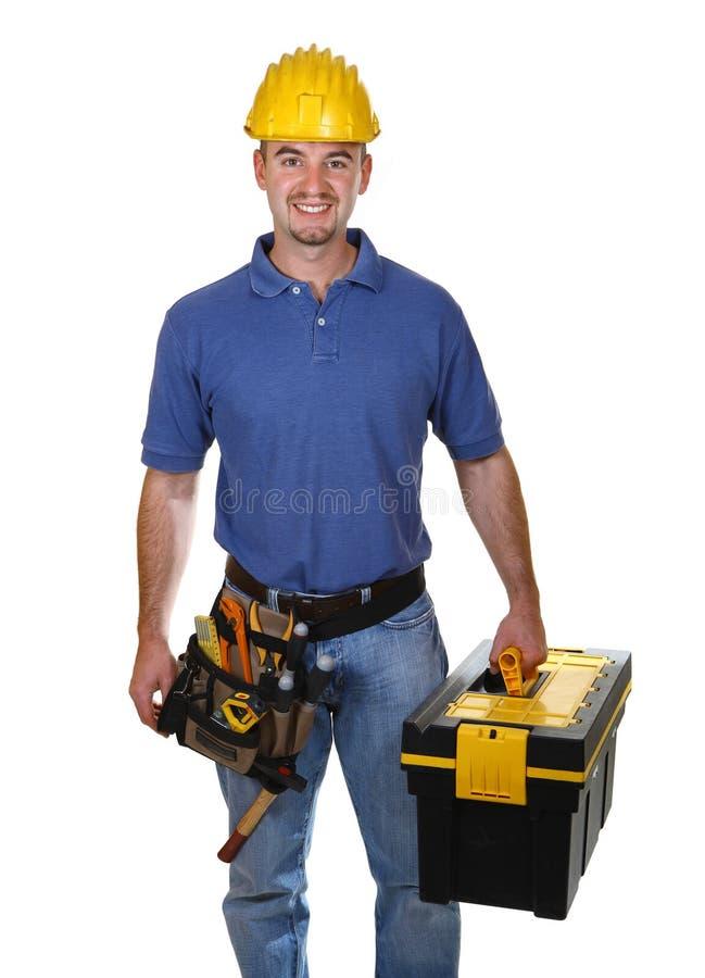 Uomo del giovane operaio con la cassetta portautensili immagini stock