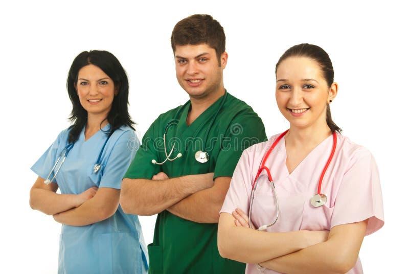 Uomo del medico con le infermiere immagine stock