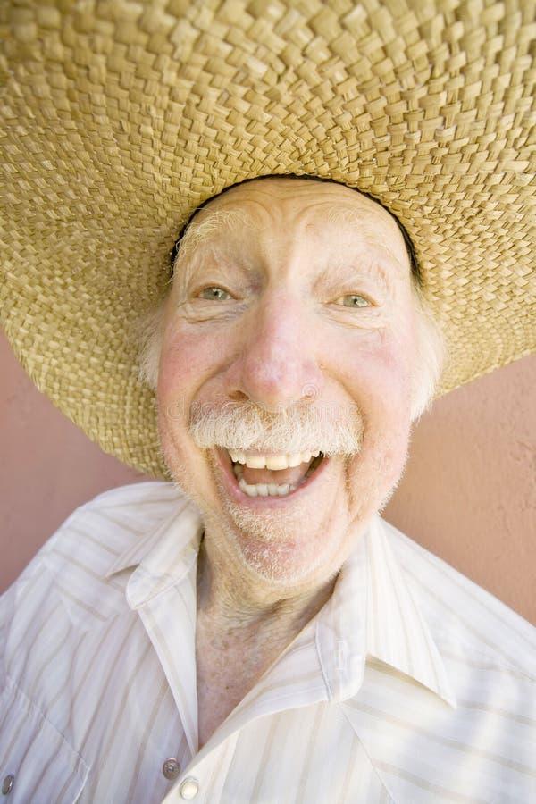 Uomo dell'anziano in un cappello del cowboy fotografia stock
