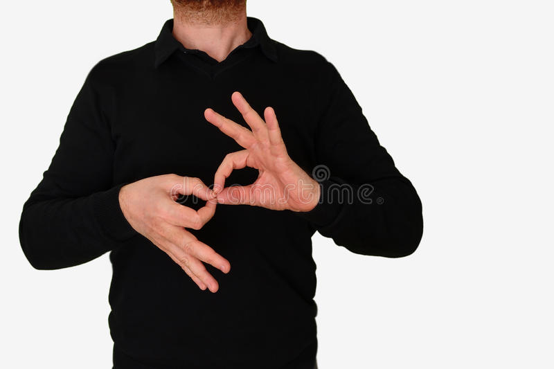 Uomo dell'interprete di linguaggio dei segni che traduce una riunione al ASL, linguaggio dei segni americano spazio vuoto della c fotografia stock