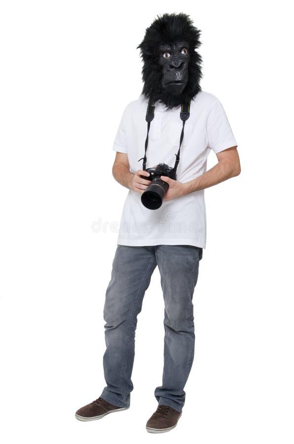 Uomo della gorilla con una macchina fotografica di DSLR immagini stock