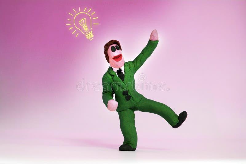 Uomo della plastilina con un'ispirazione fotografie stock