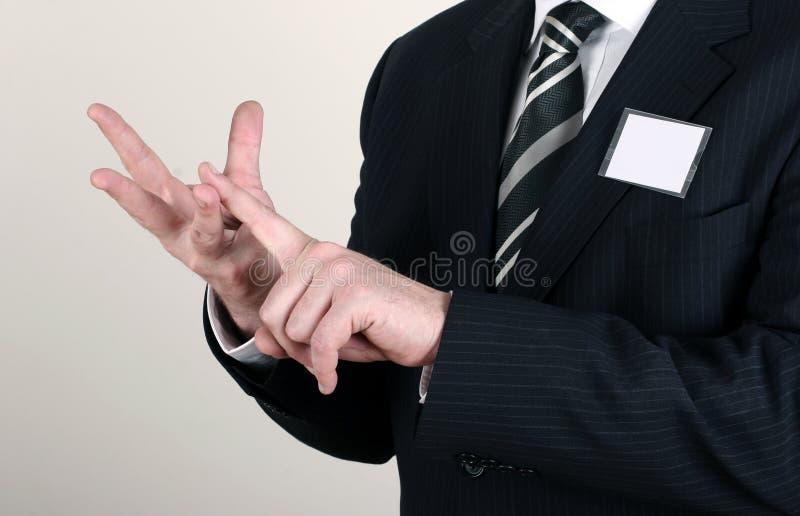 Uomo di affari che fa un punto immagini stock