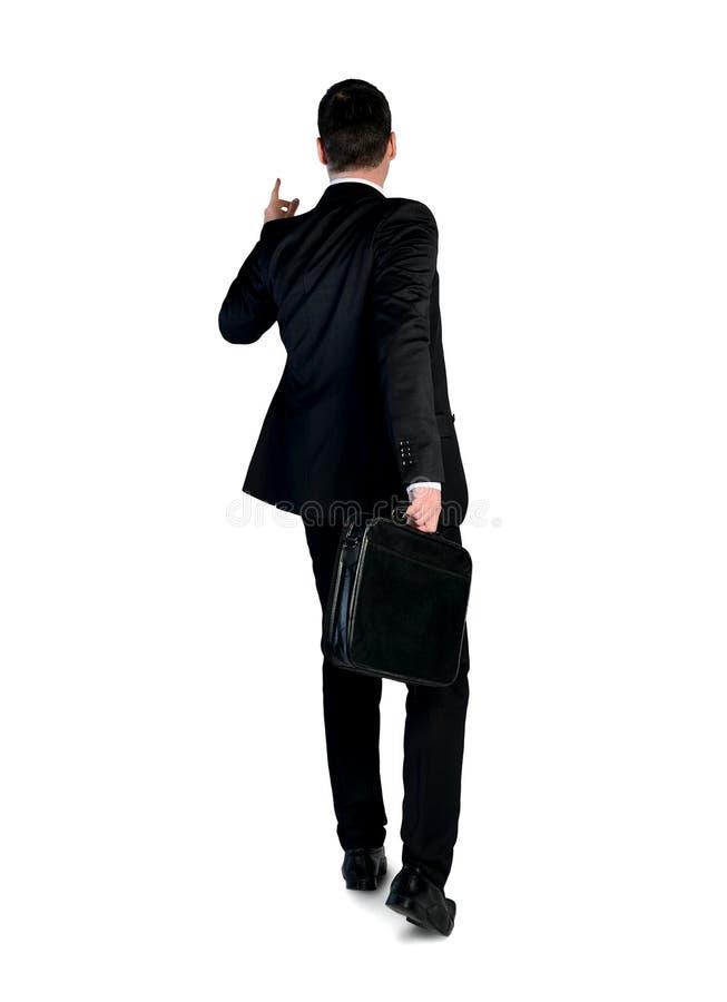 Uomo di affari che indica indietro immagini stock
