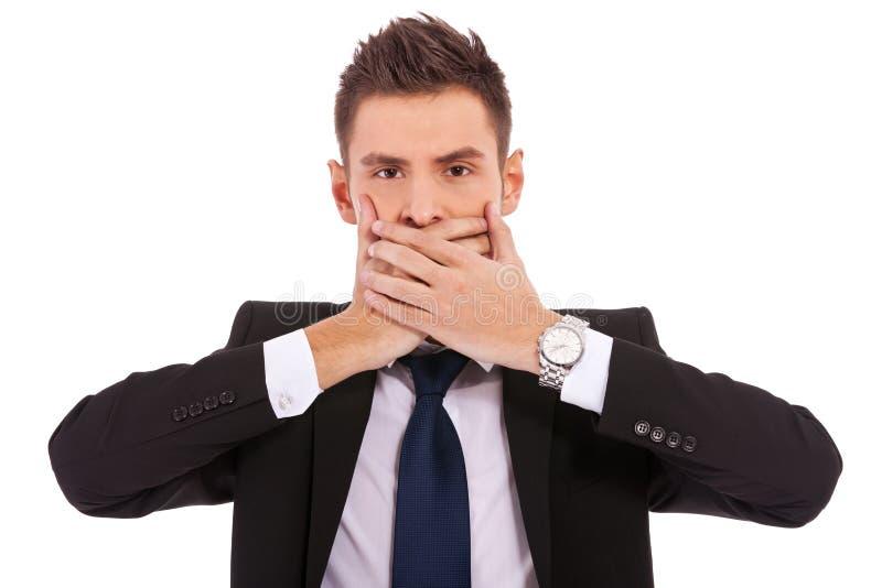 Uomo di affari che non rende al parlare gesto diabolico fotografia stock libera da diritti