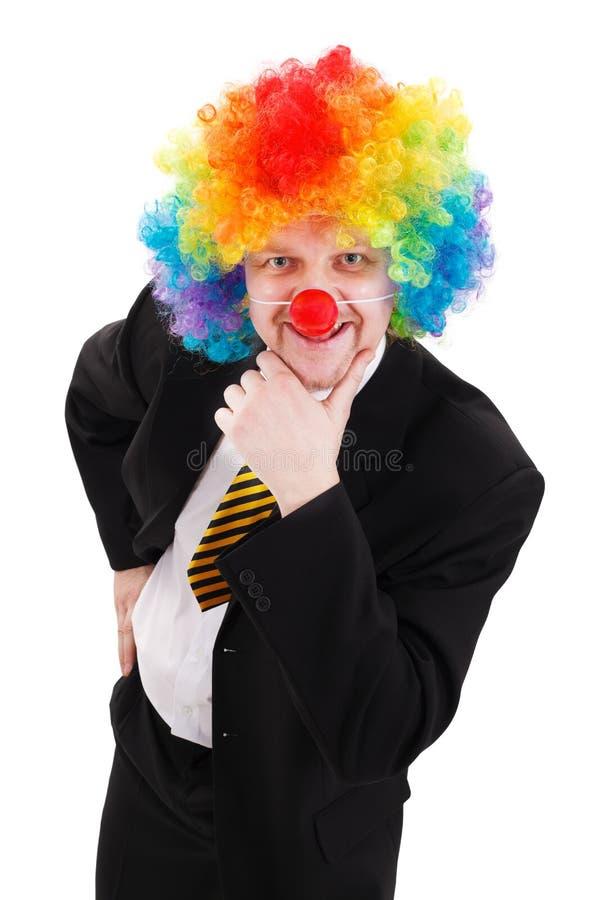Uomo di affari che porta la parrucca variopinta del pagliaccio fotografie stock
