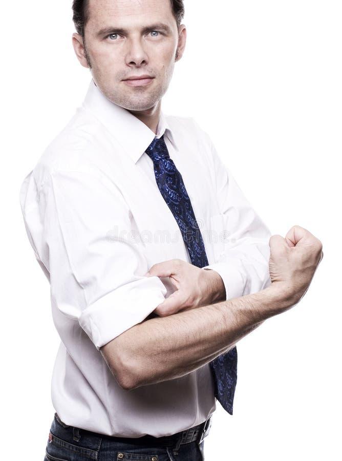 Download Uomo Di Affari Che Rotola Sui Suoi Shirtsleeves Immagine Stock - Immagine di efficiency, aghi: 30825161