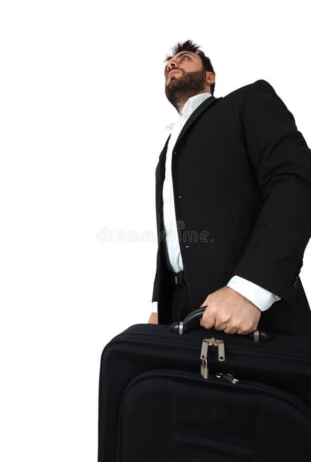 Uomo di affari che tiene breve caso e camminare immagini stock libere da diritti