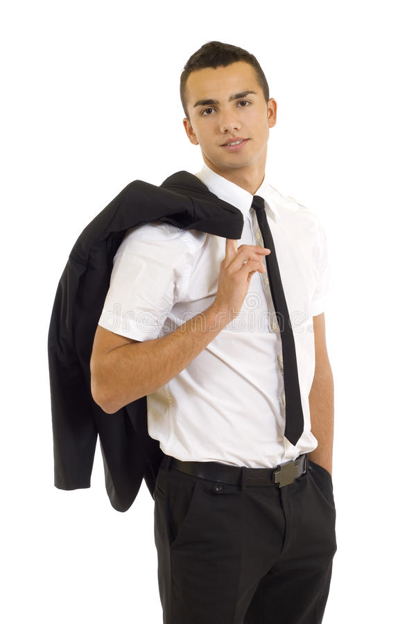 Uomo di affari che tiene il suo rivestimento sopra la sua spalla. fotografia stock
