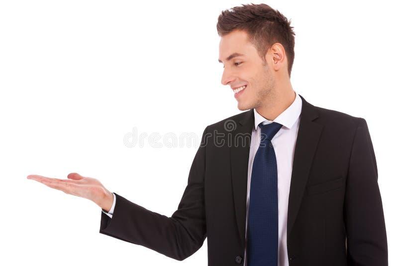 Uomo di affari che tiene mano vuota fotografie stock libere da diritti