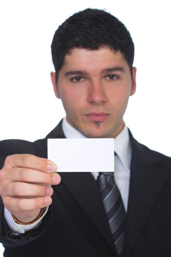 Uomo di affari che tiene scheda bianca in bianco immagine stock