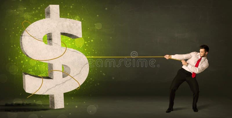 Uomo di affari che tira un grande simbolo di dollaro verde fotografie stock libere da diritti