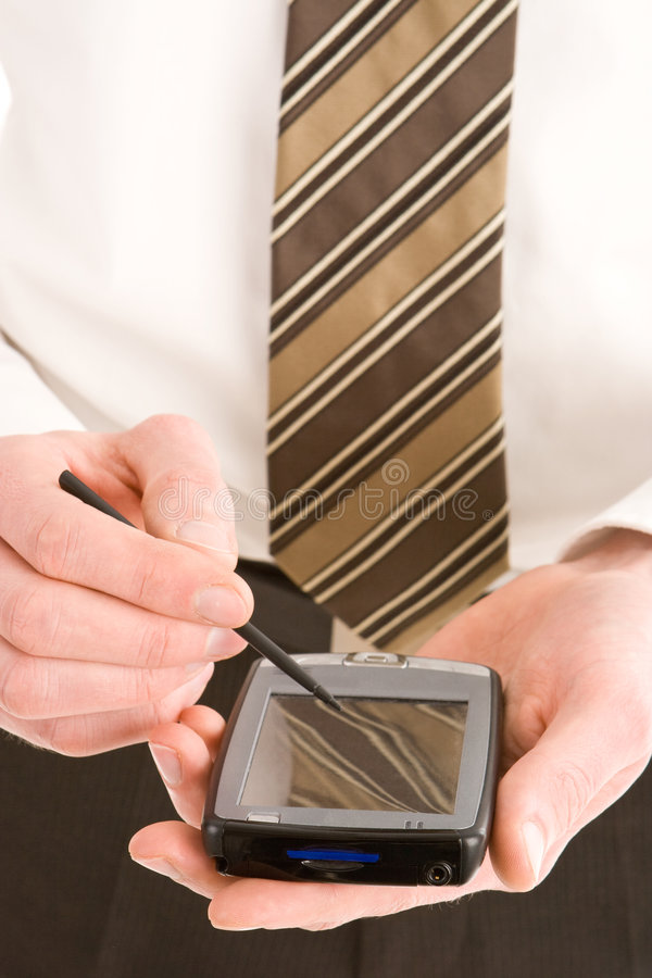 Download Uomo Di Affari Che Usando Un Pda Fotografia Stock - Immagine di professionista, tenuto: 7315924