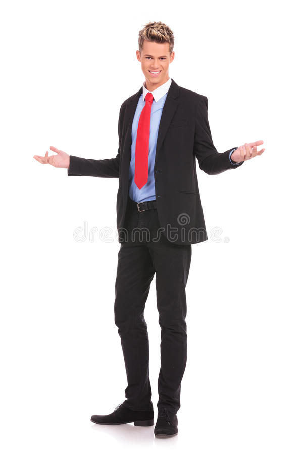 Uomo di affari che vi accoglie favorevolmente fotografia stock libera da diritti