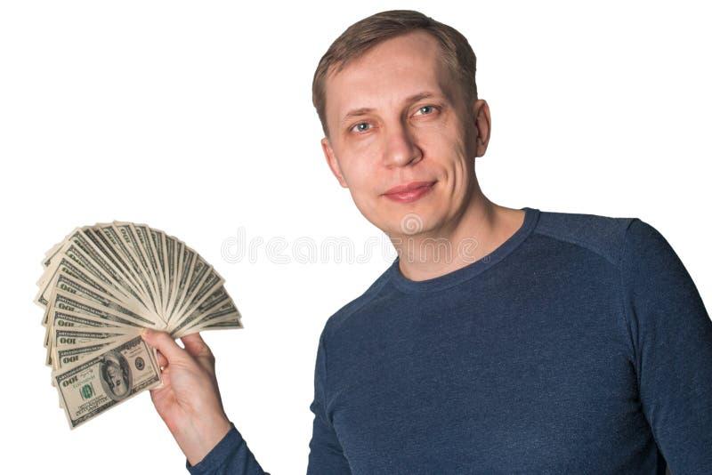 Uomo di affari che visualizza una diffusione dei dollari immagini stock libere da diritti