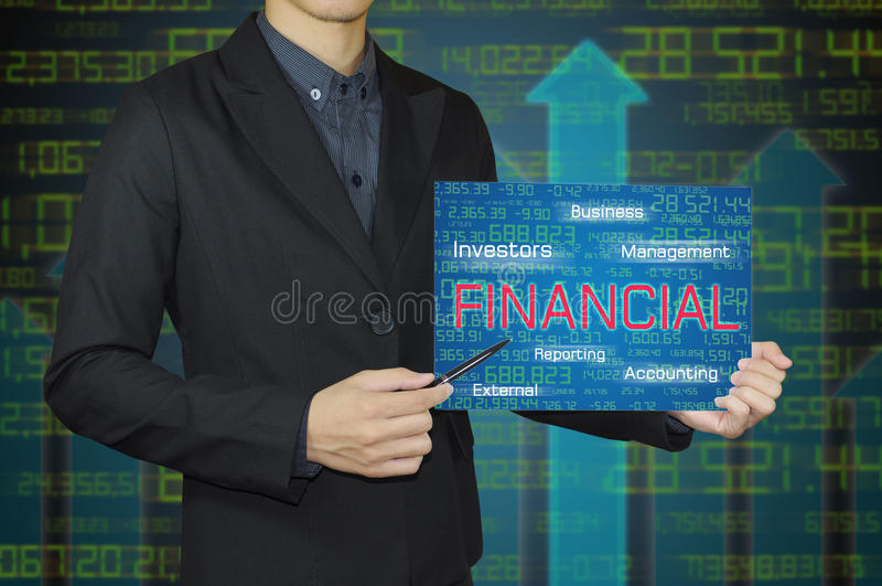 Uomo di affari con contabilità ed il concetto finanziario immagine stock