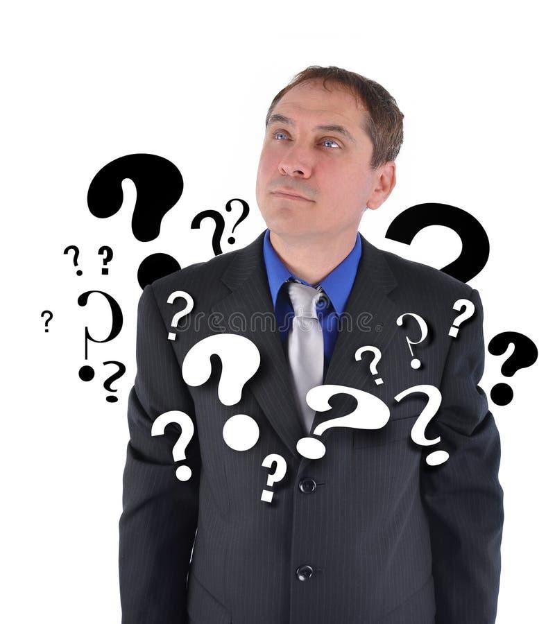 Uomo di affari con il pensiero di domande immagine stock