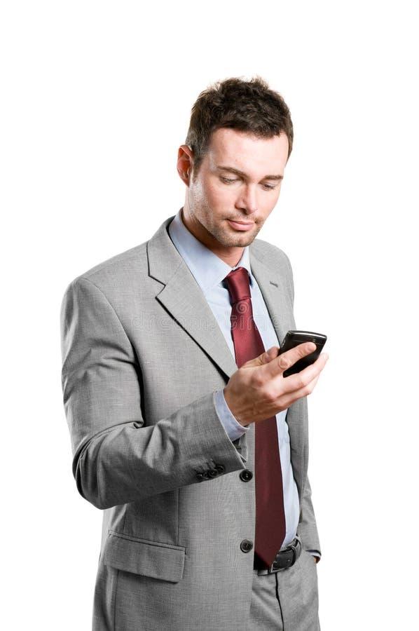 Uomo di affari con il telefono mobile di pda fotografia stock