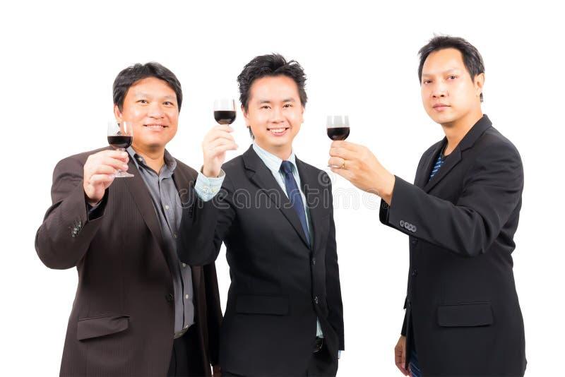 Uomo di affari con il vetro di vino fotografie stock
