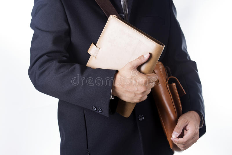 Uomo di affari con la cartella ed il libro della tenuta immagine stock libera da diritti