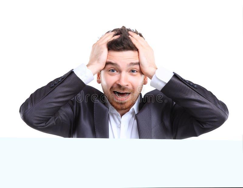 Uomo di affari con la presentazione colpita di espressione fotografie stock