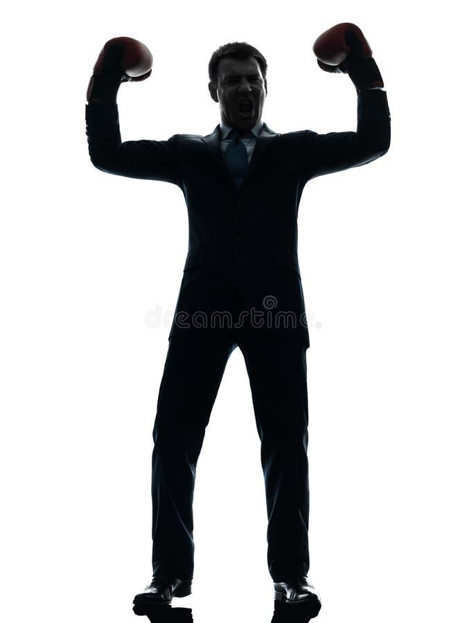 Uomo di affari con la siluetta dei guantoni da pugile fotografie stock
