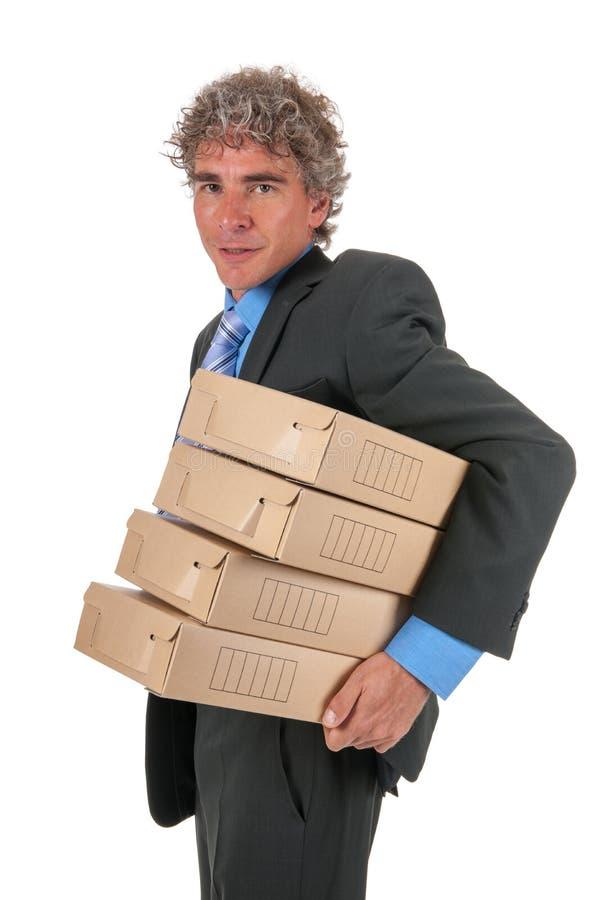 Uomo di affari con le caselle dell'archivio fotografia stock