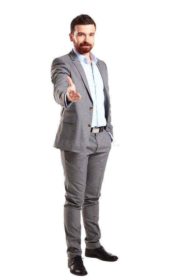 Uomo di affari con una mano aperta pronta a sigillare un affare fotografia stock libera da diritti