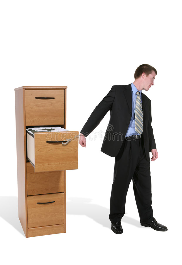 Uomo di affari concatenato per funzionare immagine stock