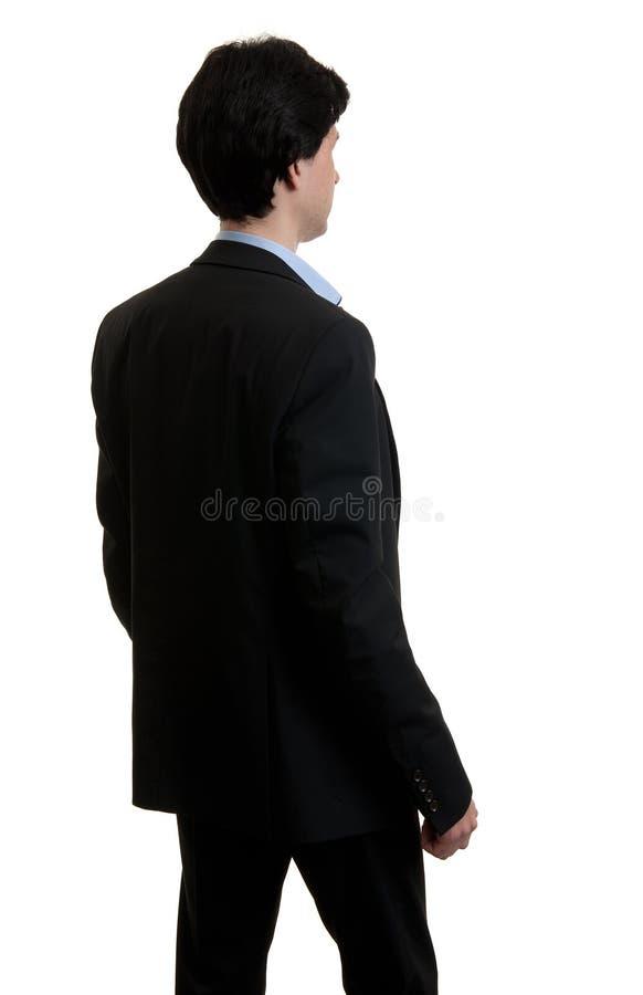 Uomo di affari dalla parte posteriore fotografia stock