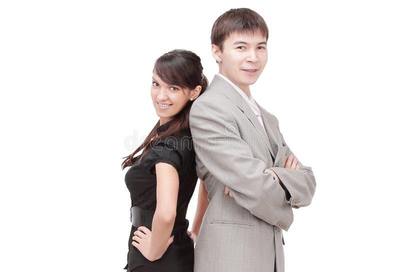 Uomo di affari e donna di affari che sta contro fotografia stock