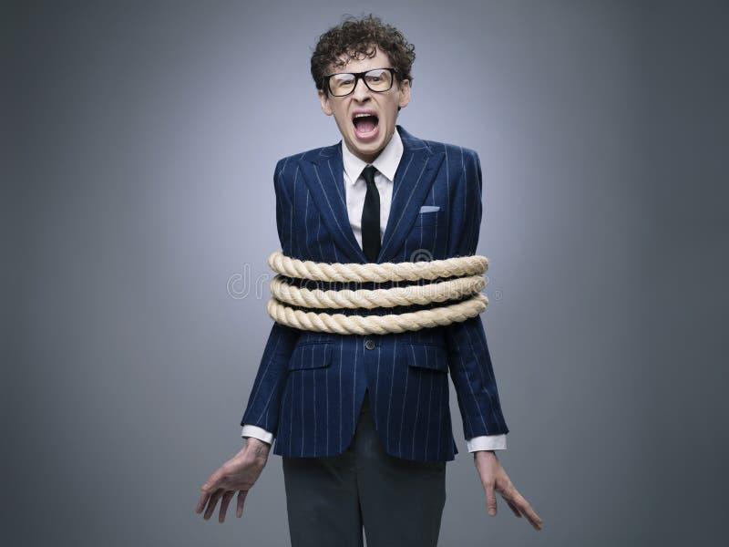 Uomo di affari legato su con la corda fotografie stock libere da diritti