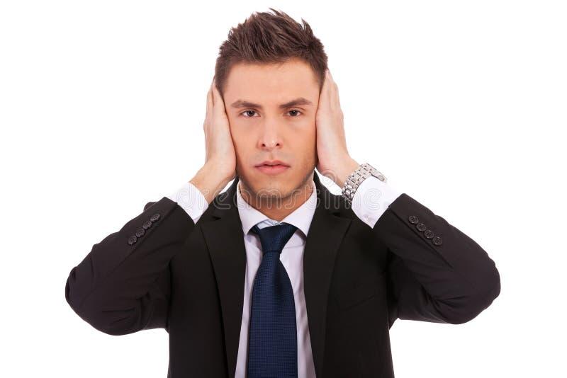 Uomo di affari nell'udito nessuna posa diabolica fotografia stock libera da diritti