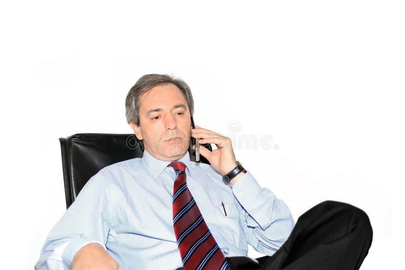 Uomo di affari sul telefono immagini stock