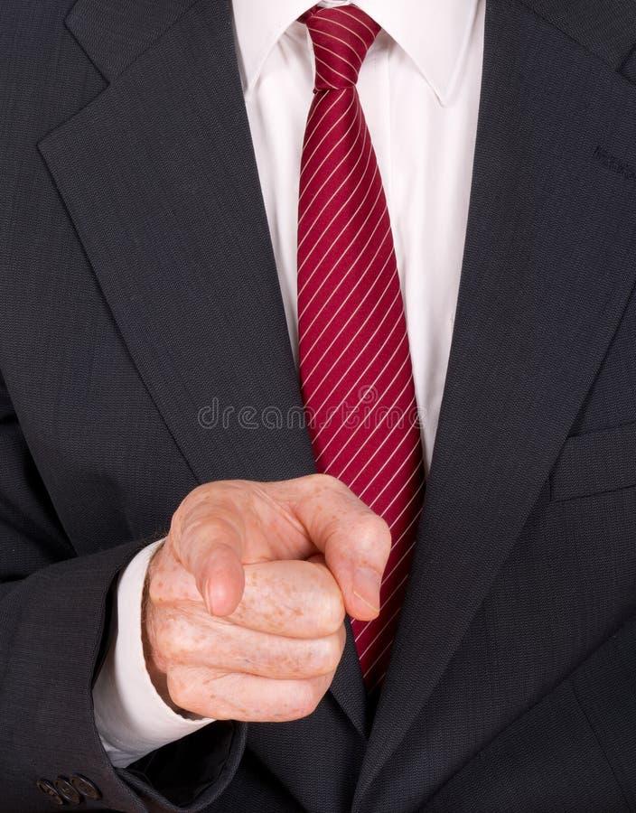 Uomo di affari in vestito che indica dito - capo, spaccone arrabbiati ecc immagine stock