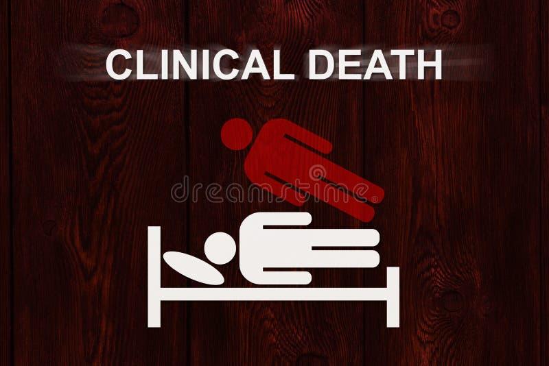 Uomo di carta sul letto con la MORTE CLINICA del testo immagine stock libera da diritti