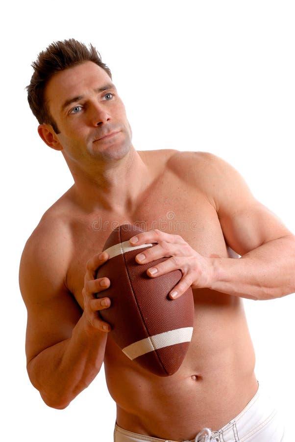 Uomo di gioco del calcio immagine stock