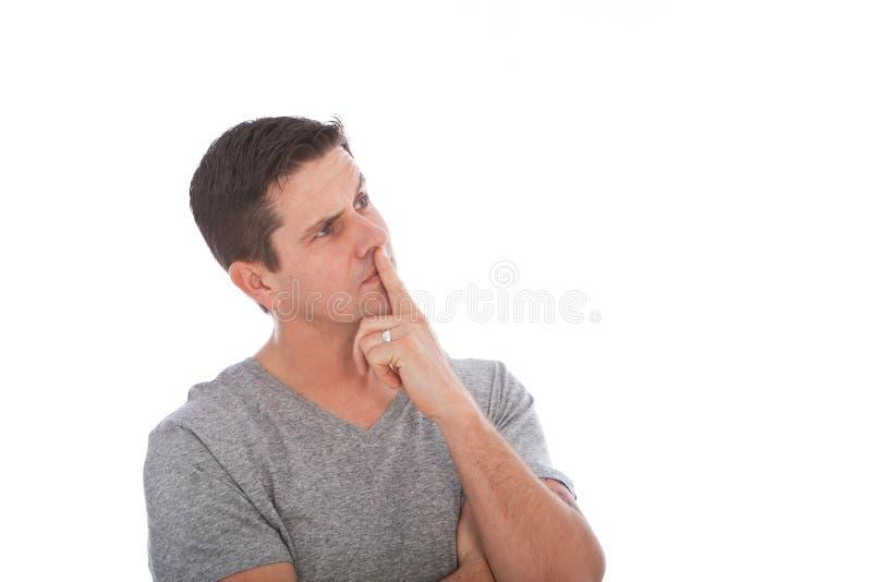 Uomo di medio evo che pensa con il dito sulle labbra immagini stock