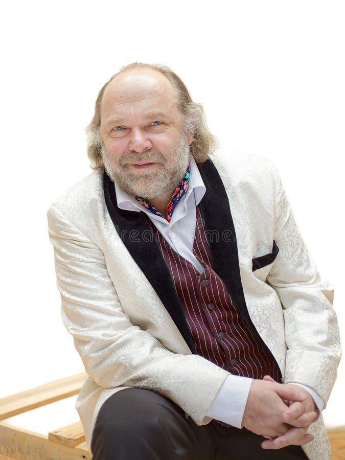 Uomo di mezza età allegro incantante con una barba immagini stock libere da diritti