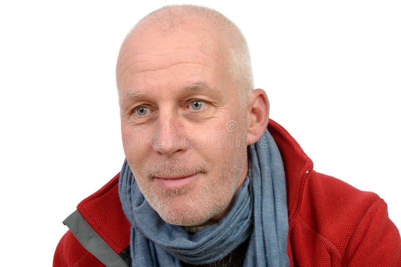 Uomo di mezza età con un rivestimento rosso fotografie stock