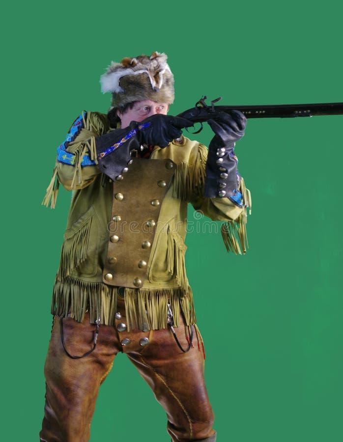 Uomo di montagna con il fucile del caricatore di museruola fotografia stock libera da diritti