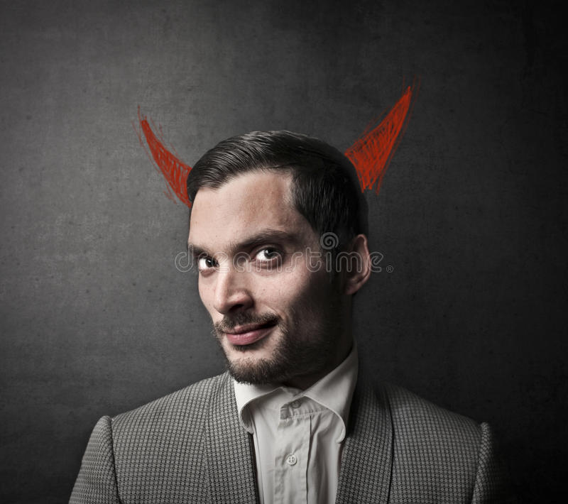 Uomo diabolico immagini stock