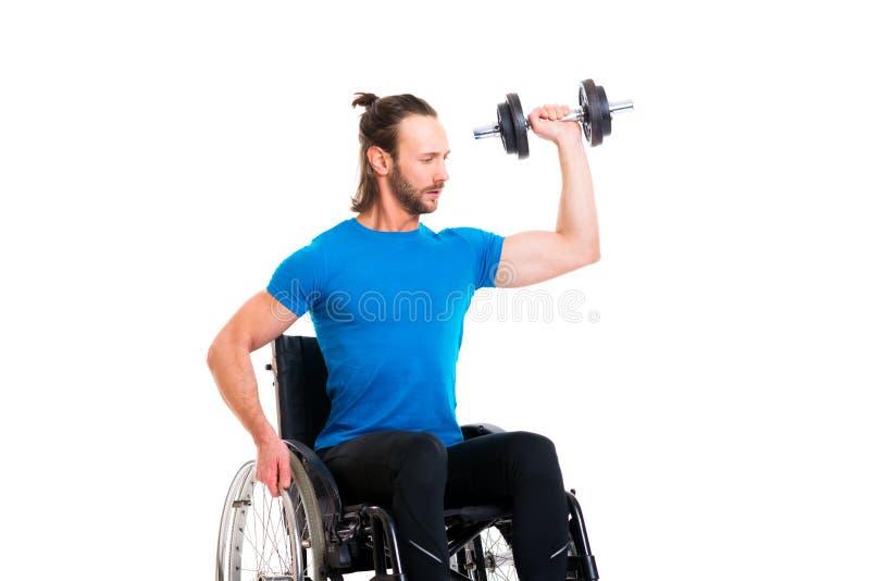 Uomo disabile in treno della sedia a rotelle con la Antivari-campana fotografie stock