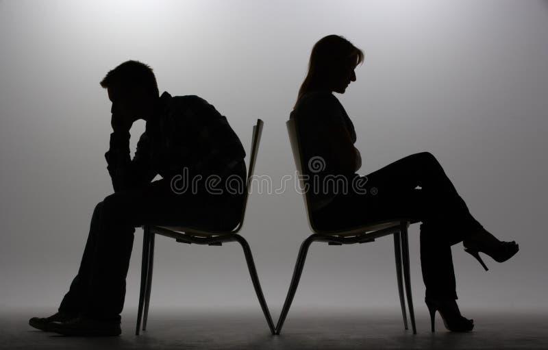 Uomo e donna in siluetta fotografia stock