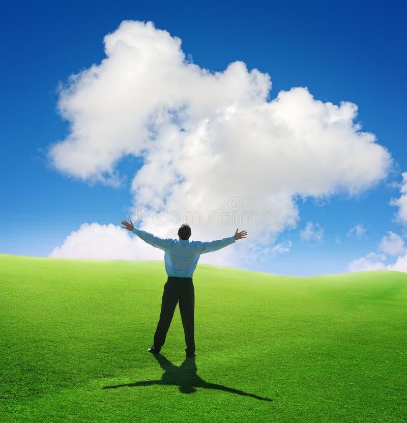 Uomo e nube fotografia stock libera da diritti