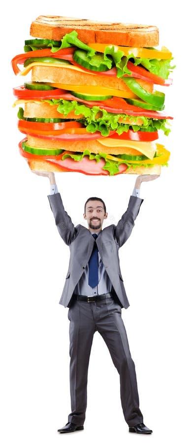Uomo e panino gigante fotografie stock libere da diritti